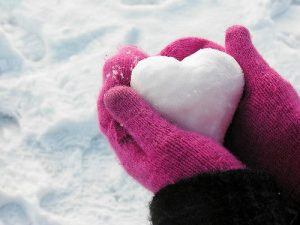 heart - heart held in pink gloves